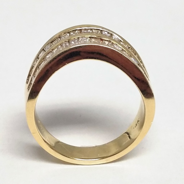 Baguette Diamond And Yellow Gold Wave Ring